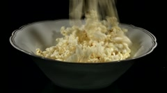 Filling up bowl with pop corn Stock Footage