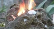 Fire behind a stone Stock Footage