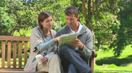 Stock Video Footage of Young couple doing a crossword