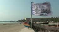 Stock Video Footage of Boat and flag waveing in dreamy beach in India 2