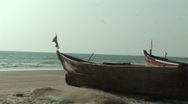Stock Video Footage of Boat and flag waving in dreamy beach in India