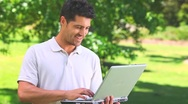 Young man chatting on his laptop Stock Footage