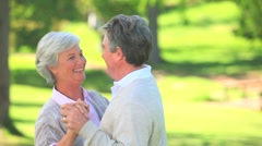 Mature couple dancing outside Stock Footage
