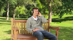 Young man listening to music oudoors Stock Footage