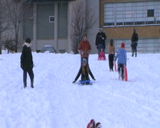 Teenagers Sled Riding Stock Footage