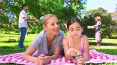 Young couple having fun with their children Stock Footage
