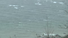 Rolling white Capped waves and Driving rain over Stormy lake - stock footage