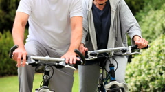 Mature couple on bycycles having a break - stock footage