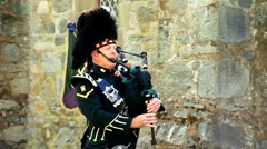Scottish bagpiper Stock Footage