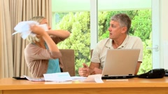 Exasperated wife throwing bills at her husband - stock footage