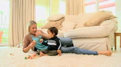 Baby on carpet bored with building blocks - stock footage