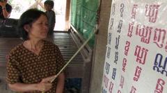 Cambodia: Woman Teaches Literacy Stock Footage