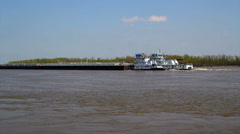 Double barge headed up the Mississippi River Stock Footage