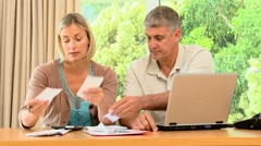 Couple getting nervous because of their bills Stock Footage