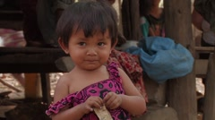 Cambodia: Baby Plays with Money Stock Footage