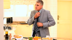 Businessman in suit hurriedly taking his breakfast Stock Footage