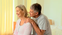 Attentive man massaging his wife's shoulders - stock footage