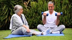 Mature couple excersising Stock Footage