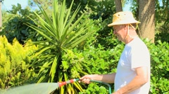 Man watering his garden Stock Footage