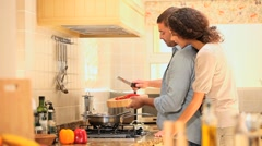 Young woman and boyfriend cooking Stock Footage