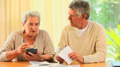 Mature couple sorting out their accounts Stock Footage