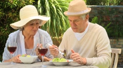 Mature couple having lunch in the garden Stock Footage