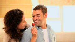 Woman taunting her boyfriend with a strawberry Stock Footage