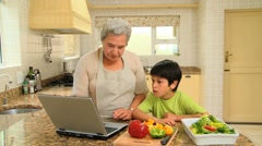 Woman teaching grandson how to cook - stock footage
