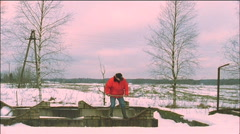 A man digging snow Stock Footage