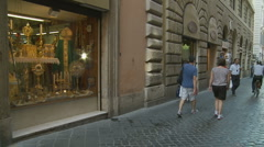 Nun walks past religeous shop in Rome - Glidecam Stock Footage