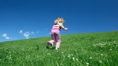 Preschool girl rise on hill Stock Footage