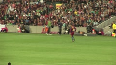 Stock Video Footage of Pique, FC Barcelona player, getting ball and passing to Iniesta