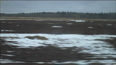 Snowy fields passing by from car window - stock footage