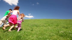 Family holding hands up hill Stock Footage