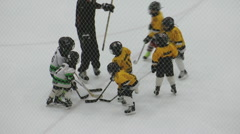 Young Children Playing Minor Ice Hockey - stock footage