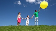 Happy family with bubble on hill Stock Footage
