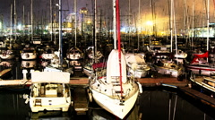 Barcelona port vell harbour boats 4k night Stock Footage