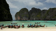 Stock Video Footage of Long tail wooden boats at Maya Bay, Phi phi island, Thailand, Tropical Beach