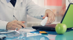 Male doctor writing rx prescription HD Stock Footage