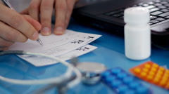Male doctor writing rx prescription HD - stock footage