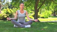 Relaxed woman doing the lotus position Stock Footage