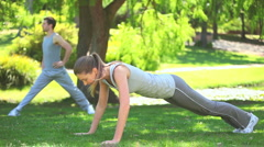 Stock Video Footage of Couple doing musculation exercises