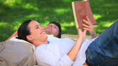 Couple lying on the grass Stock Footage