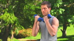 Handsome man doing musculation exercises - stock footage