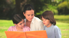 Stock Video Footage of Mother with her children looking at an album