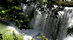 Spring rain runoff over falls, zoom out and pan left  JPEG A 70% Stock Footage