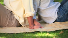 Lovers sitting on the grass in the park Stock Footage