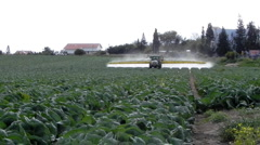Agriculture toxic tractor spraying pesticides crops fertilize organic duster Stock Footage