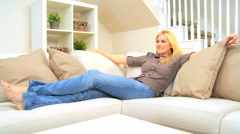 Blonde Girl Relaxing at Home Stock Footage