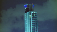 Timelapse of clouds over skyscraper Stock Footage